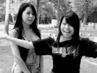Two Asian Girls in a Cemetery
